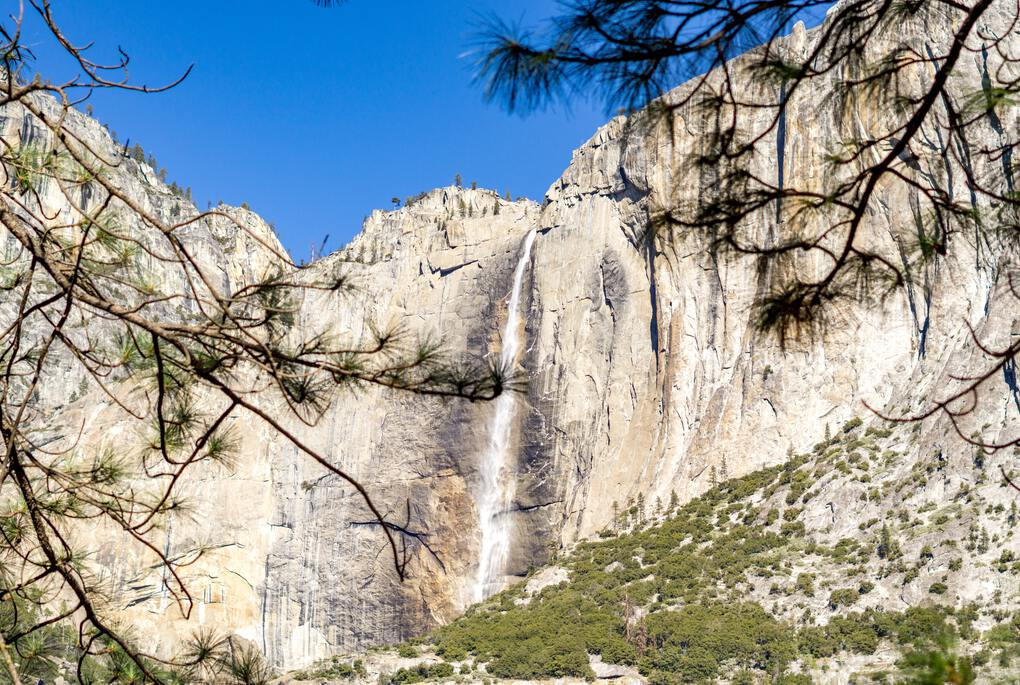Cascading waterfall down a mountain in the Yosemite National Park